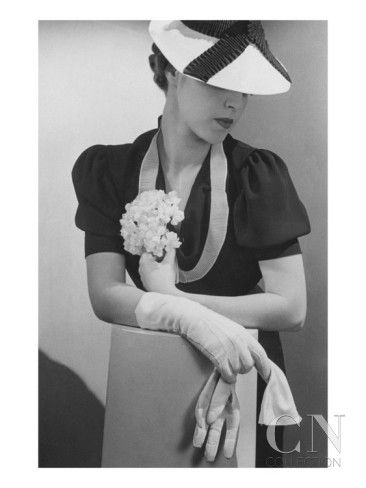 Vogue - April 1936 - Woman Holding Small Bouquet Poster Print by Lusha Nelson at the Condé Nast Collection