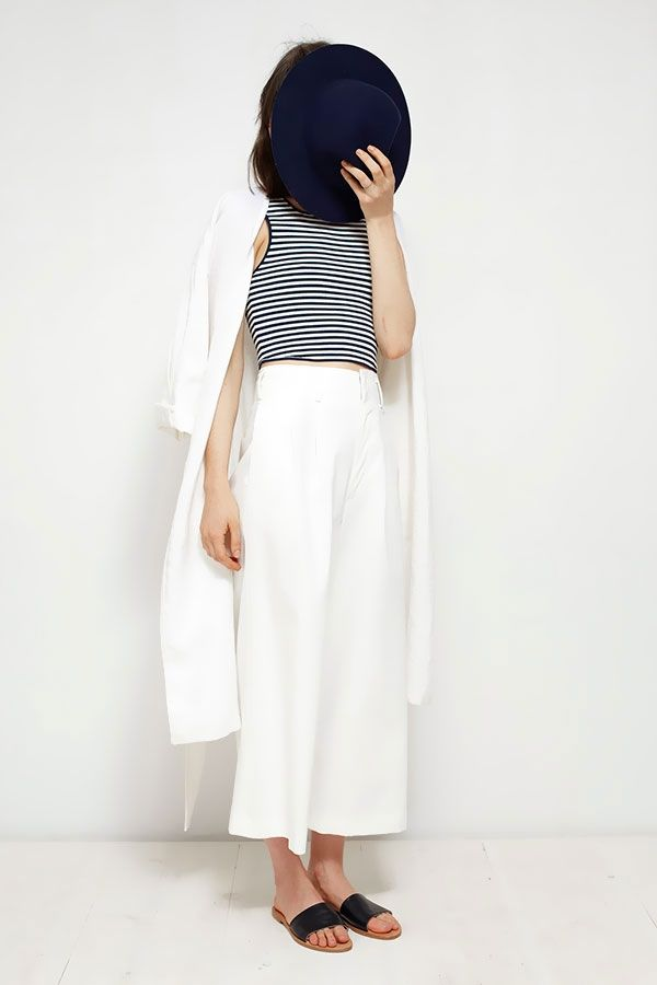 Black and white striped top with white pants