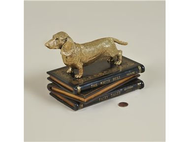 Maitland Smith Accessories Amber Finished Cast Brass Dachshund On Stack Of Multicolored Leather Books 1059 294 Maitland Smith Leather Books Hickory Furniture