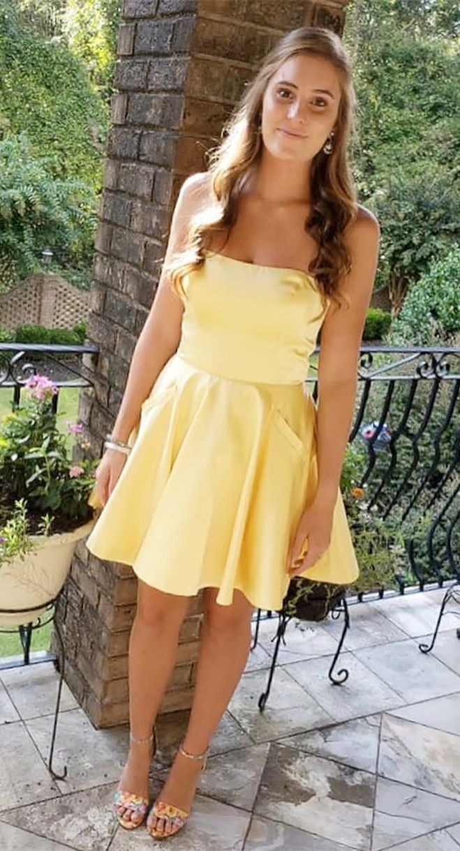 Simple strapless short yellow homecoming dress with pockets en