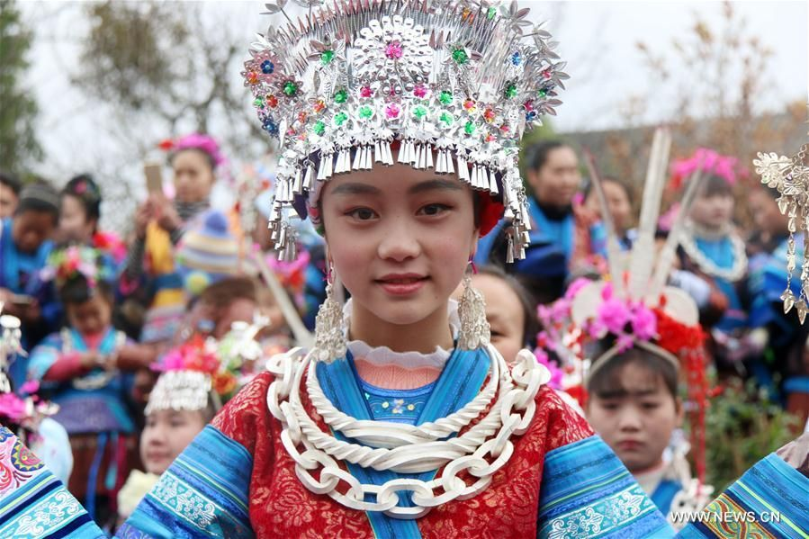 People of Miao ethnic group take part in 'Ganpingzi,' a 200-year-old folk event held on the 7th day of a lunar new year's first month, to pray for a good fortune in Gaoqing Miao Village of Diping Township of Liping County, southwest China's Guizhou Province, Feb. 3, 2017.