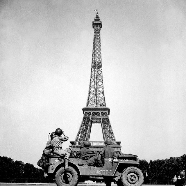 Soldiers of the 4th U.S. Infantry Division look at the Eiffel Tower in Paris, after the French capital had been liberated on August 25, 1944.