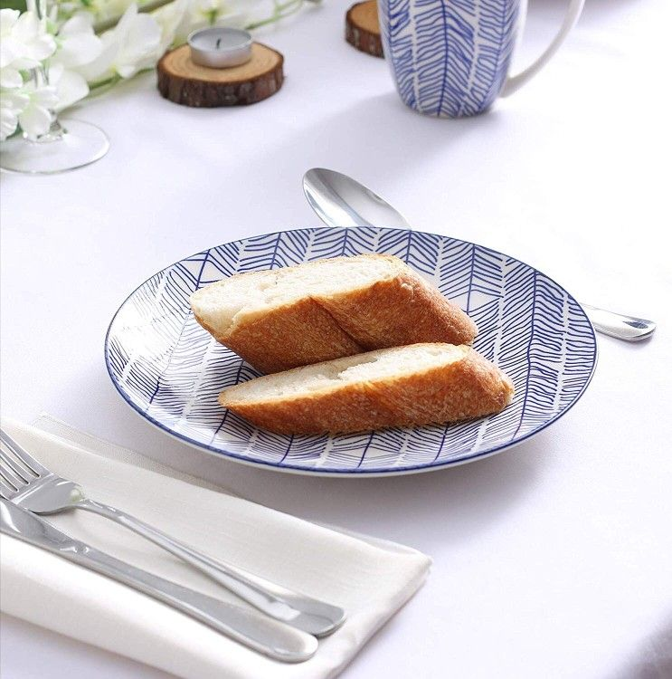 فطور شهي بأطباق مميزة Dish Dishes Plate Bowl Cup Blue Bluecup Bluedesign Bowlset Diningtabledecor Lighting Redsquare Food Breakfast Toast