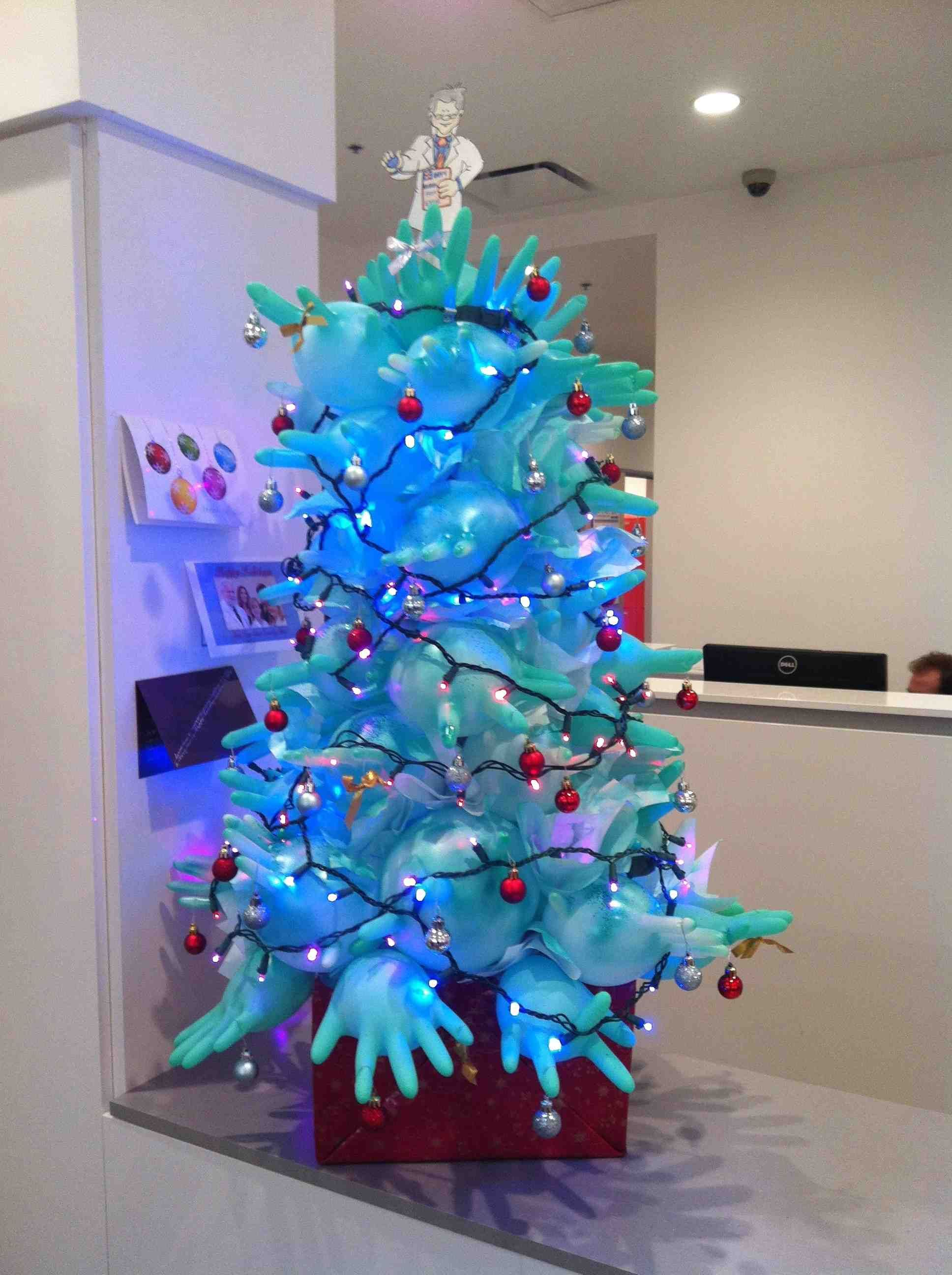 Rubber Glove Alternative Christmas Tree With Paint Glitter And Holiday Lights Office Christmas Decorations Amazing Christmas Trees Christmas Tree Themes