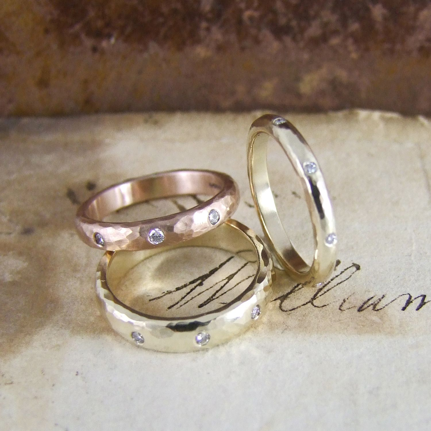 Beaten Wedding Rings by Alexis Dove in #rosegold #yellowgold #hammeredgold set with white diamonds