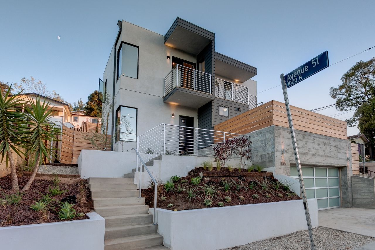 Complete remodeled home with landscape exterior (With