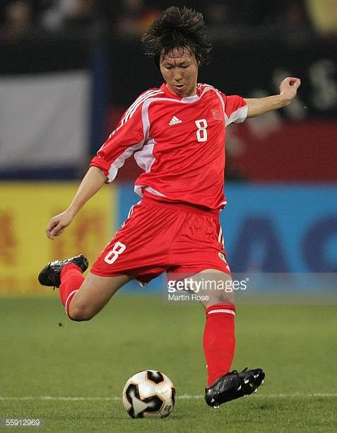 Tie Li of China runs with the ball during the friendly game between Germany and China at the AOL Arena on October 12 2005 in Hamburg Germany