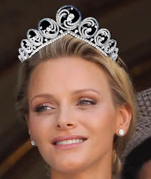 Princess Charlene in her new tiara that can also be a necklace. Do you think it looks a little crooked?