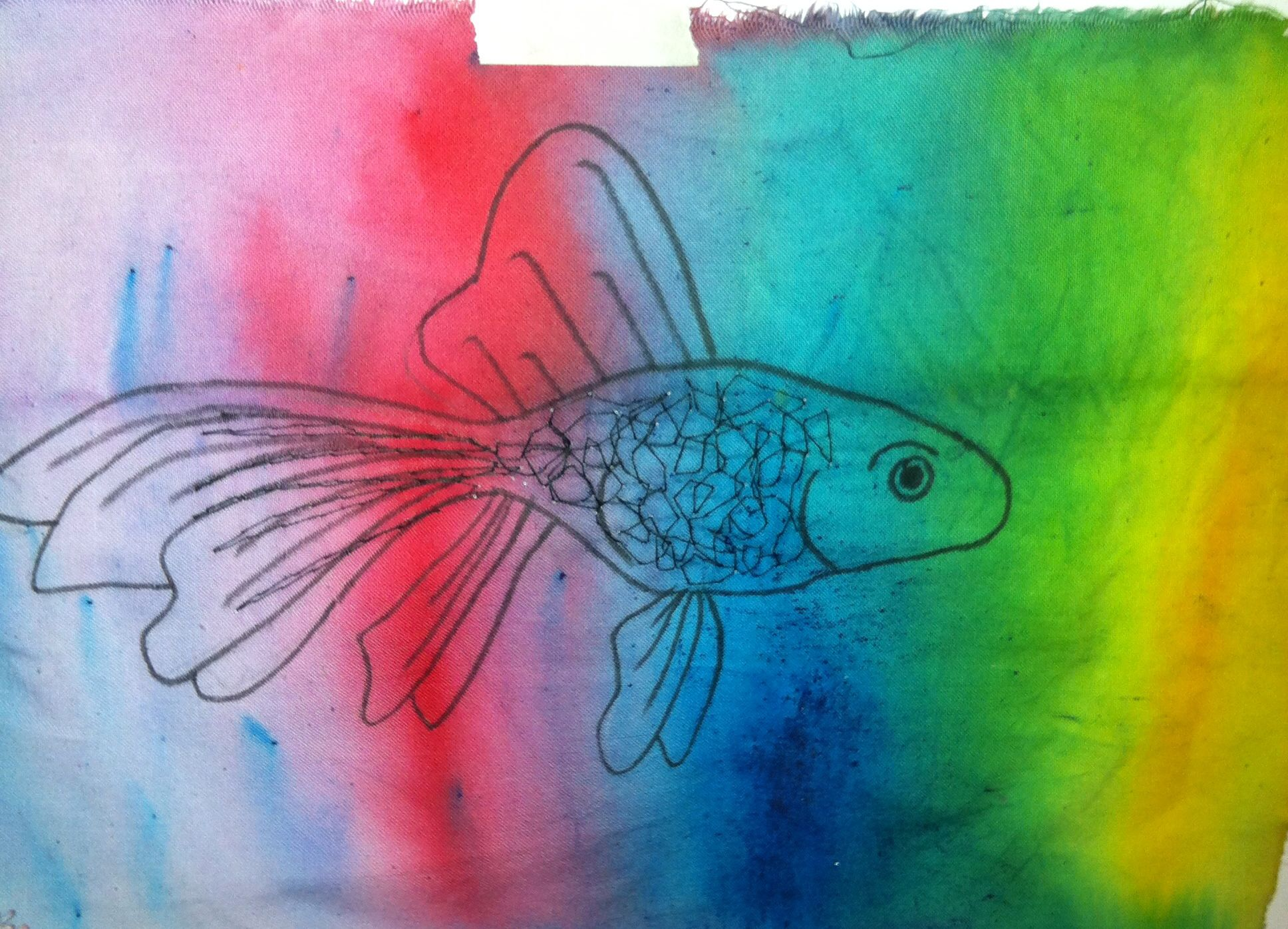 Using paint brusho's dyeing the calico fabric and then drew the fish on top #fish
