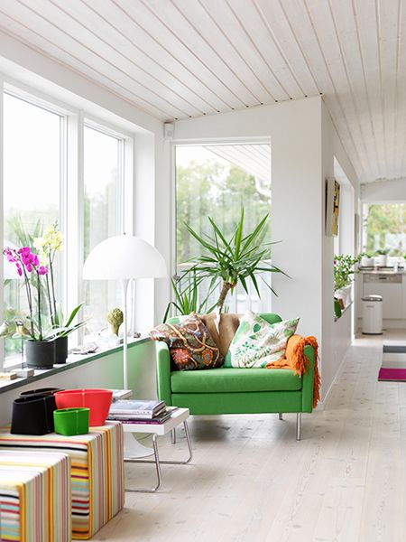 green chair, striped cubes, white slat ceiling