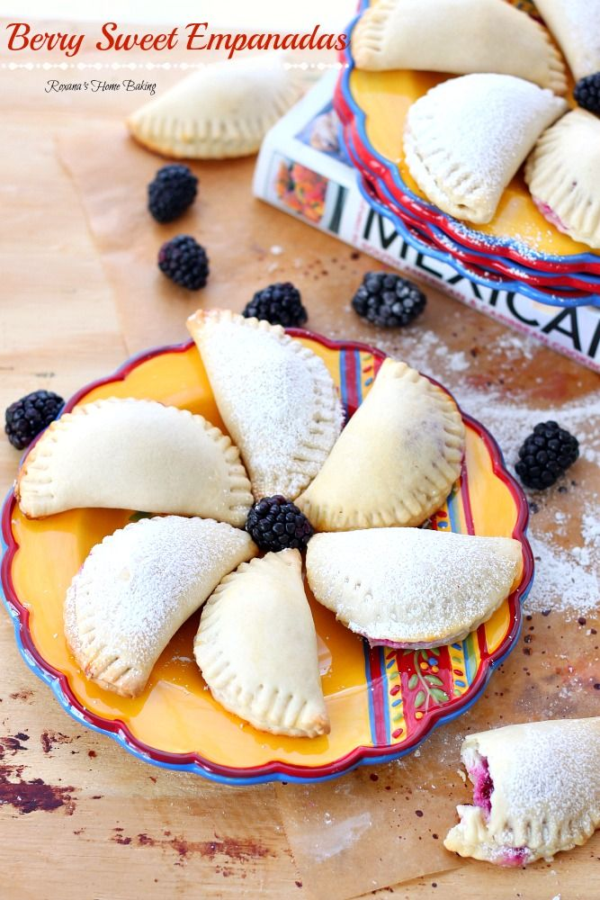 Flaky pastry pockets filled with creamy ricotta and a juicy blackberry sauce - A sweet twist on traditional empanadas.