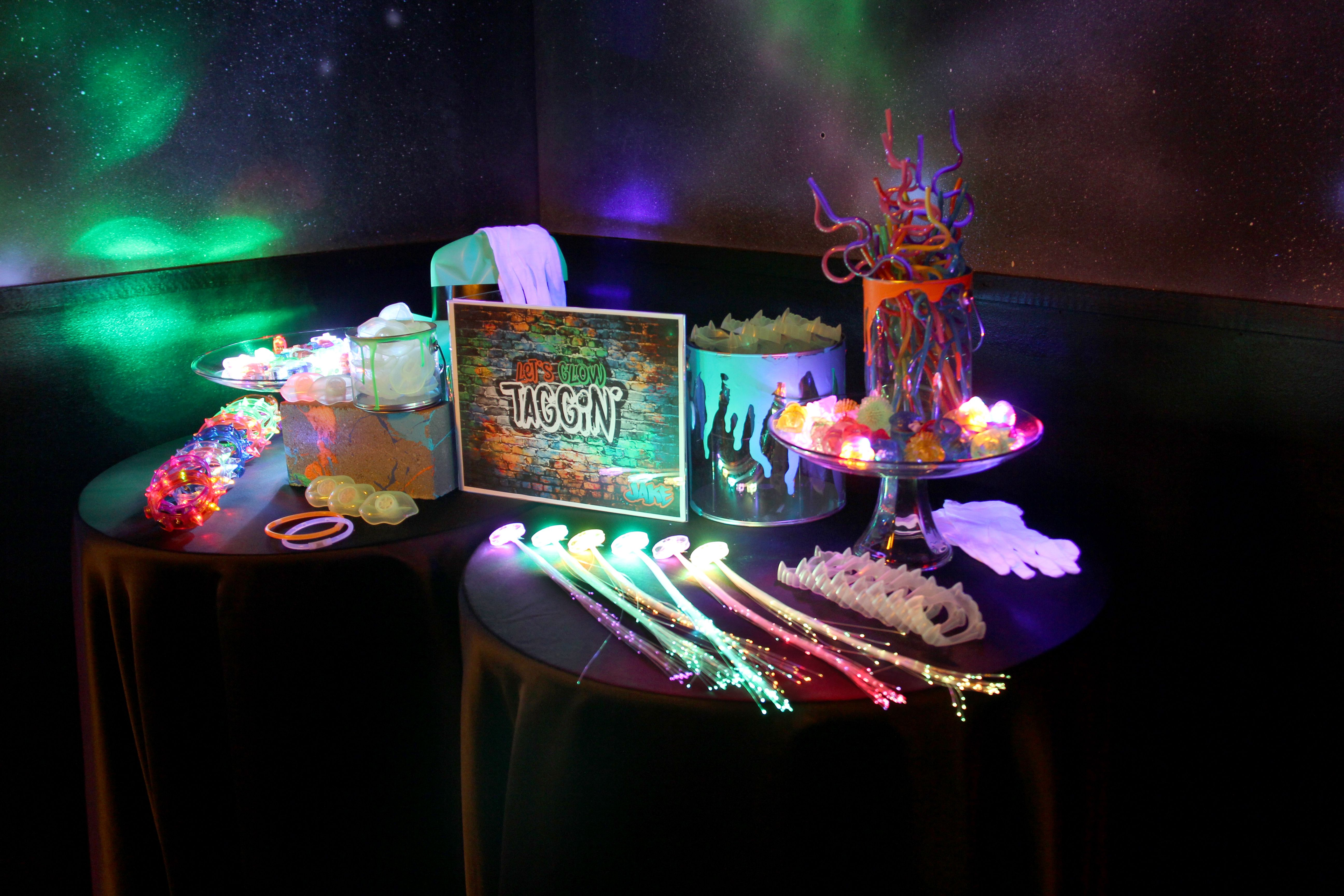 glow in the dark favor table for a graffiti glow party at stratum laser tag