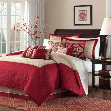 Update your room with the ruby bedding collection this quilted polyester set features a deep Master bedroom with red bedding