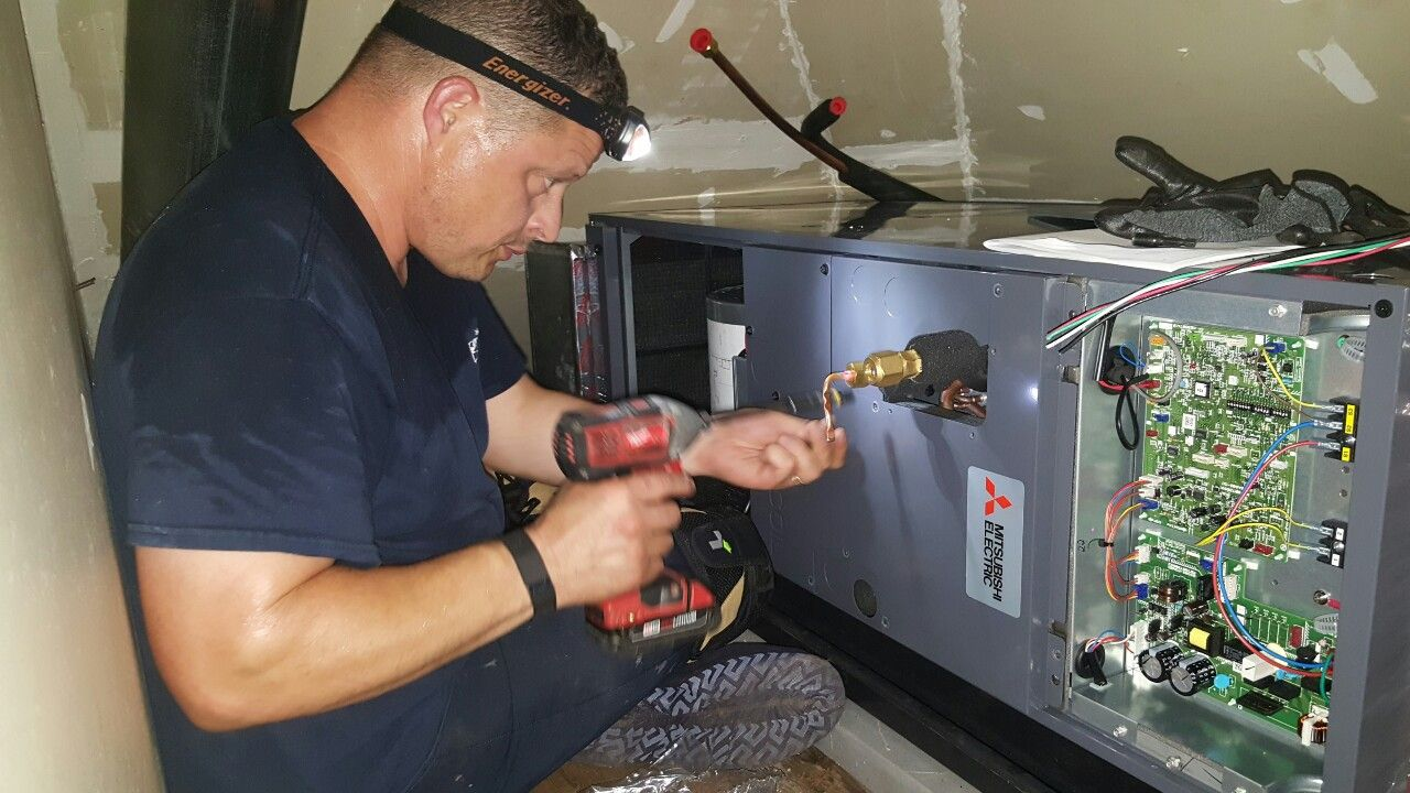Compass Heating and Air technician, Mike G., installing a