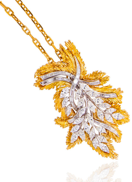 A diamond pendant and chain, comprising a pendant, designed as a marquise and baguette diamond-cut diamond foliate spray, with a textured gold surround; and a fancy link chain