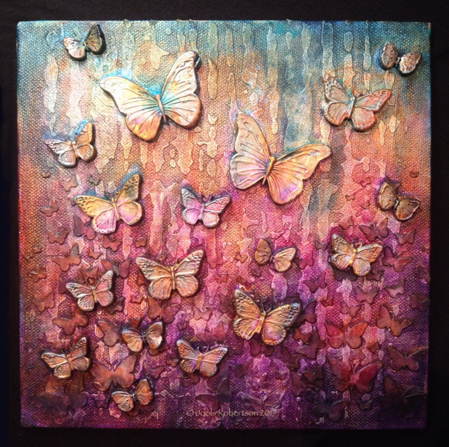 Apply media crackle paste through stencils onto a canvas base embellish with paper clay butterflies apply media fluid cobalt