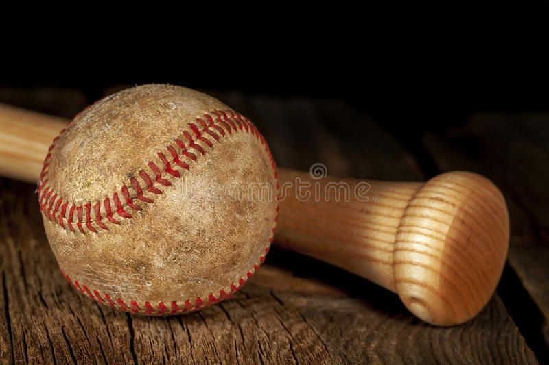 Old Baseball And Bat An Old Worn Baseball And Wood Bat On Wood Surface With Bla Ad Worn Wood Baseball Bat Black Ad Wood Bat Bat Wood