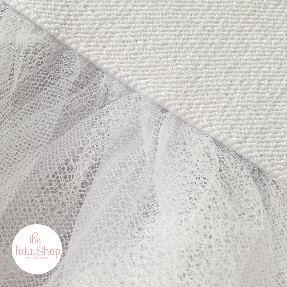 A beautiful detail of our over-knee white hand-tied white tutu skirt inspired by prima ballerina's.  This version is over-knee length and is triple layered for extra volume, the bodice is stretchy to enable a perfect fit.  Upkeep - hand wash & iron inside out