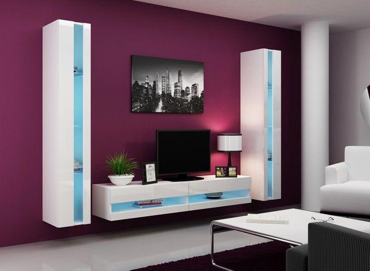 Boy is een modern compleet tv-wandmeubel bestaande uit twee kolomkasten met in het midden een tv-meubel, optioneel tegen meerprijs verkrijgbaar met blauwe LED verlichting, dit wandmeubel is gemaakt van hoogwaardig gelamineerd plaatmateriaal verkrijgbaar in de kleuren Mat Wit of Mat Zwart gecombineerd met Hoogglans witte of Hoogglans zwarte MDF fronten.   De complete set bestaande uit: - Tv-meubel B180 x D40 x H30 cm - 2x Kolomkast B30 xD40 x H180 cm ( Optioneel tegen meerprijs verkrijgbaar…
