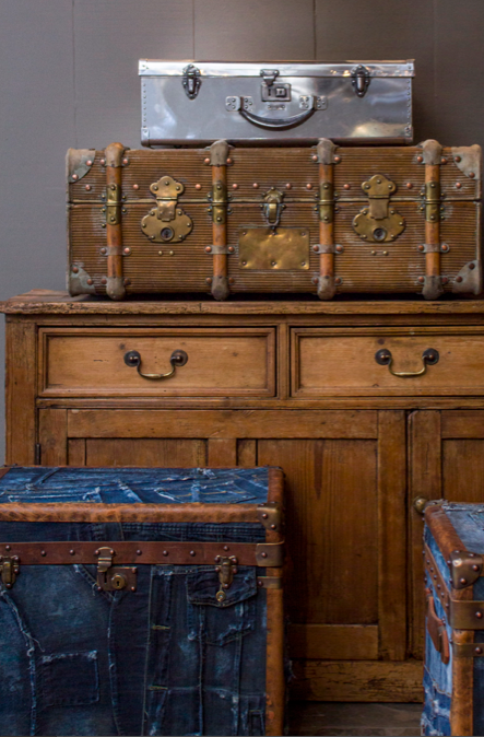 selection of worn trunks and suitcases