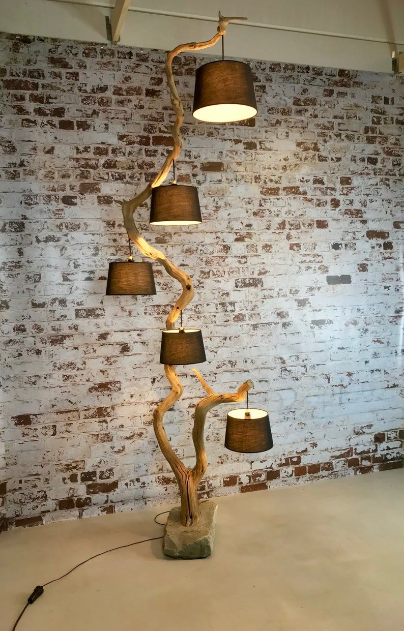 Floor lamp from old Oak branch on boulder with five pendants including lampshades.