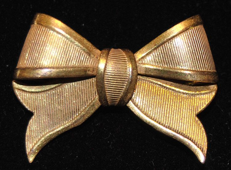 signed miriam haskell goldtone bow by karenscollectables25 on Etsy https://www.etsy.com/listing/237144740/signed-miriam-haskell-goldtone-bow