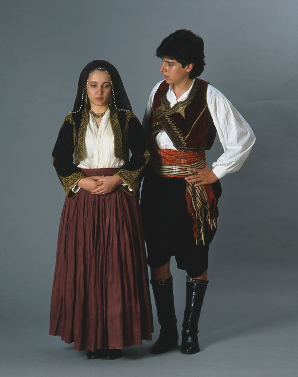"""The festive (Greek) Cypriot man's and woman's (""""rouziettin"""") dresses. - Clothing style: 1900's."""