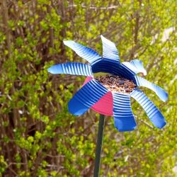 Spruce up your garden and attract colorful birds with this recycled craft.