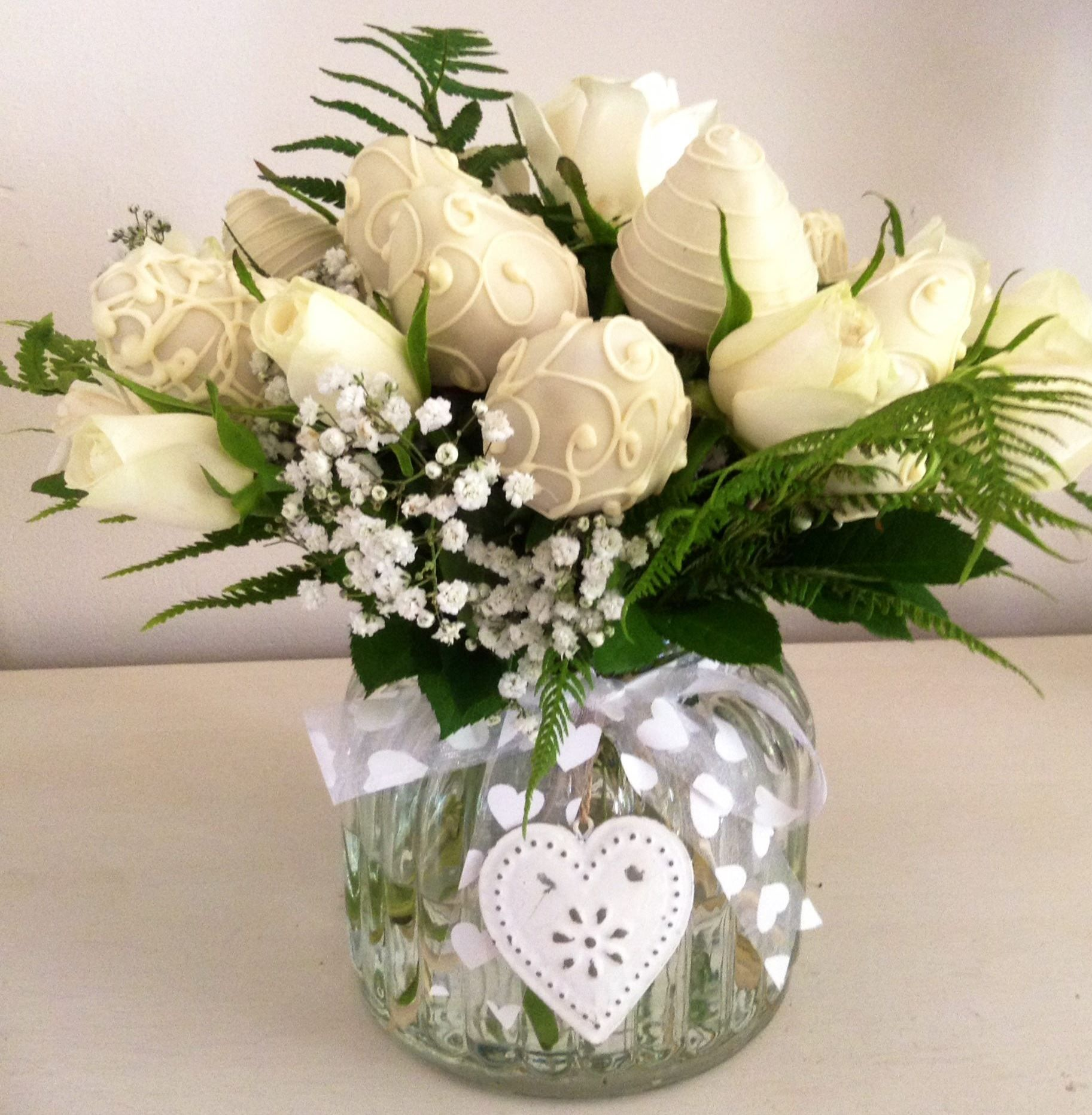 Glass vintage jar with fresh ivory roses and chocolate dipped strawberry bouquet!