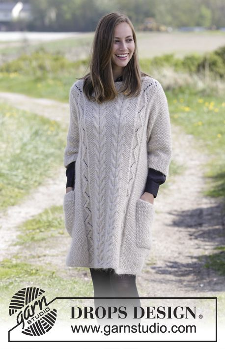 Knitted jumper with moss stitch, cables, lace pattern and pockets ...
