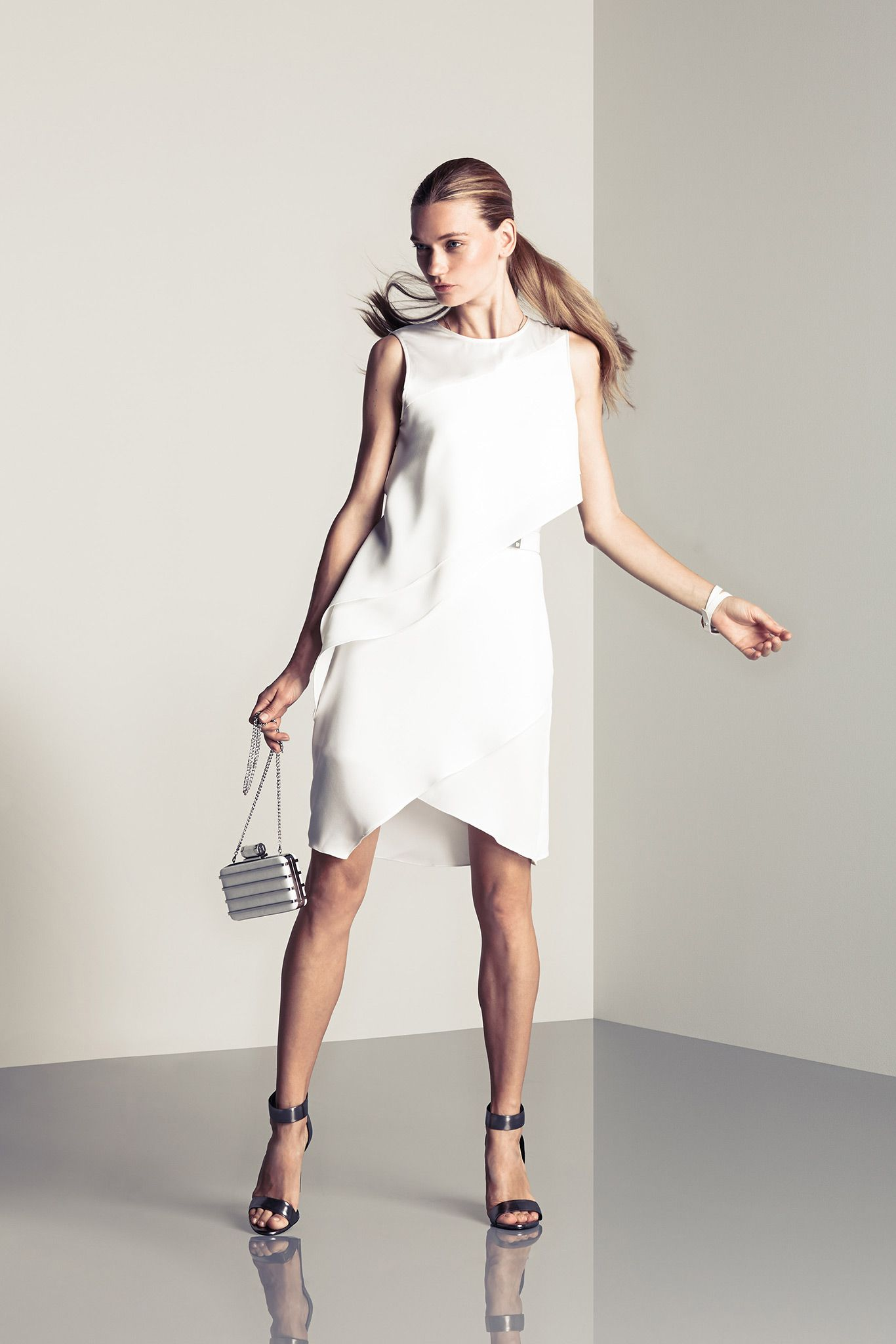 Halston Heritage | Spring 2015 Ready-to-Wear | 37 White sleeveless mini dress with asymmetrical hem