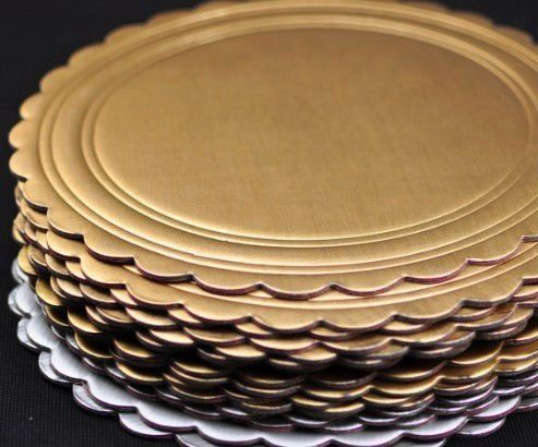 Use cake rounds as plate chargers but I would paint them with black chalk board paint