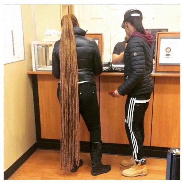 Long dreads down to her ankles Very long dreads Long