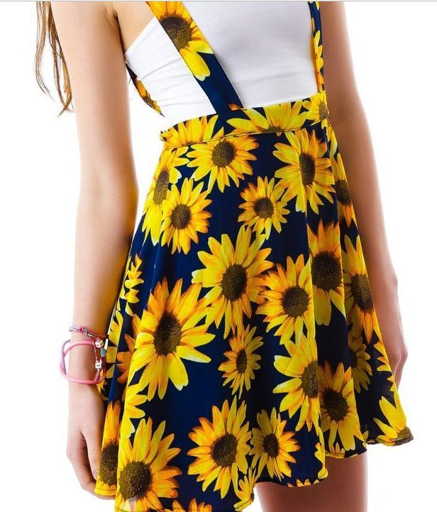 6005af4a5cb Sunflower printed dress styled like overalls. Sunflower skirt with  suspenders