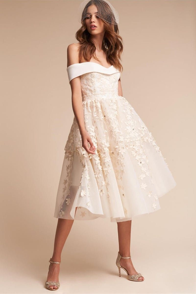 Loving the short hem of this nontraditional offtheshoulder