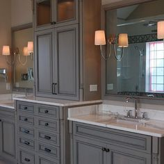 double sink vanity with center cabinet. Master bath tall cabinet in center of 2 sinks  Google Search