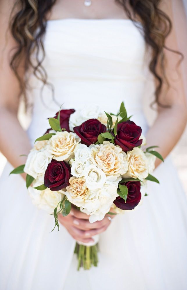 Small Round Bridal Bouquet Made Of White Yellow Red Roses