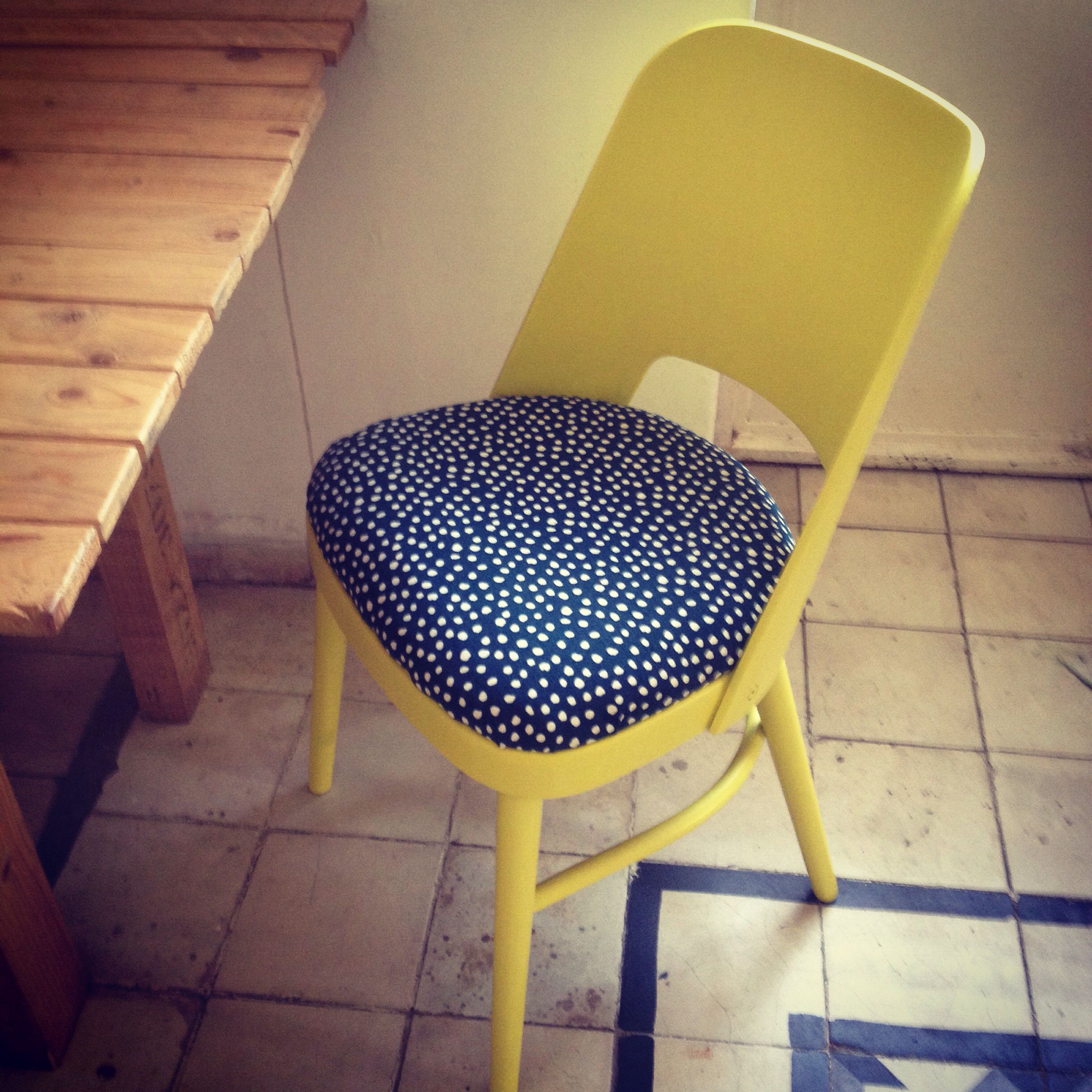 Hand made wood chair lemonyellow painted with a bluewhitedotted
