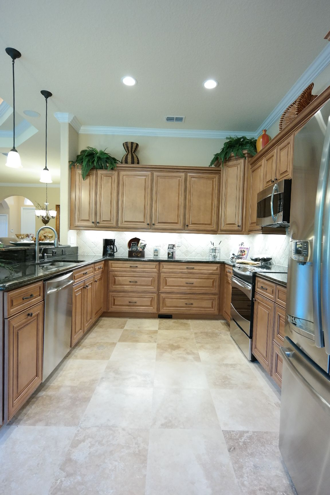 This Kitchen Features Granite Countertops, Stainless Steel Appliances, 36 Maple