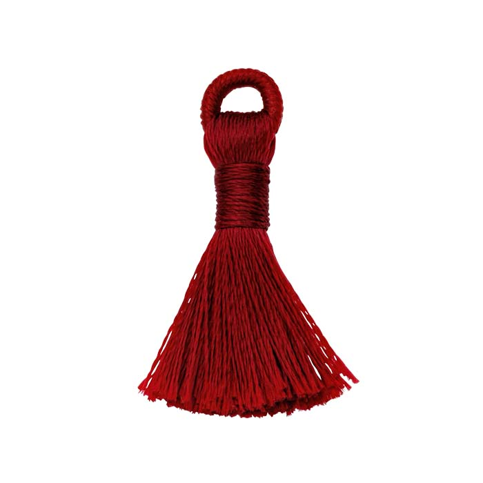 """Burgundy Silk 1"""" Tassel with Thread-Wrapped Ring Created from hand-dyed silk thread, this satiny burgundy tassel has a variety of design possibilities—as necklace and bracelet dangles, a charm element, lightweight earring drops, package decorations, and more! Combine several tassels of the same color for a solid color palette, or use a mixture of colors to create a custom combination. The attach ring is silk thread tightly wrapped around a slim, strong nylon cord."""