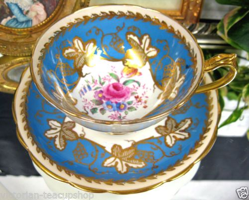 PARAGON TEA CUP AND SAUCER BLUE AND GOLD GILT TEACUP PAINTED ROSES GOLD GILT