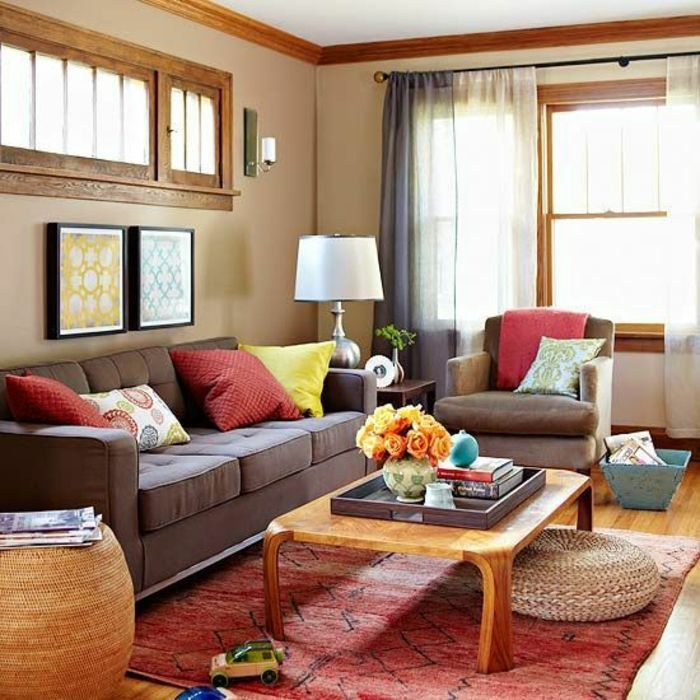 two tone living room walls, pale orange walls with wooden details - Brown Couch Living Room