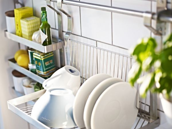 Think like an urban European and hang your dish rack on the wall ...