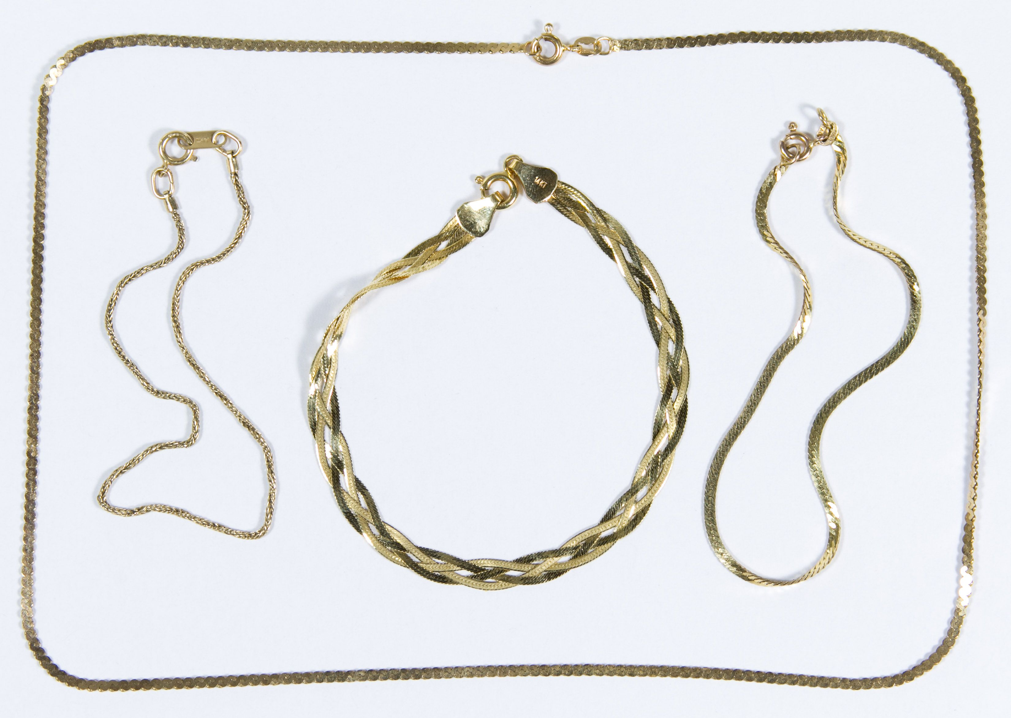 Lot 306: 14k Gold Jewelry Assortment; Four pieces including three bracelets and a necklace