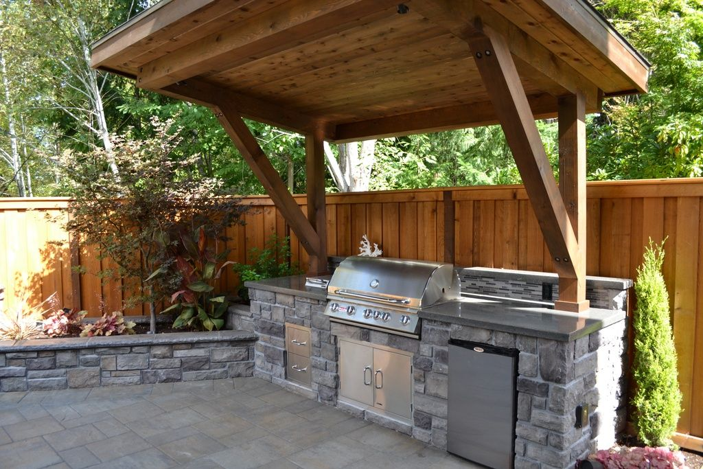 rustic patio with polished concrete exterior stone floors fence stacked stone raised - Patio Kitchen Ideas