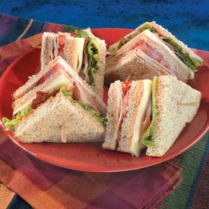 Swiss cheese, tomato, bacon, lettuce and turkey piled on wholesome, whole grain bread with creamy dressing make a classic sandwich.