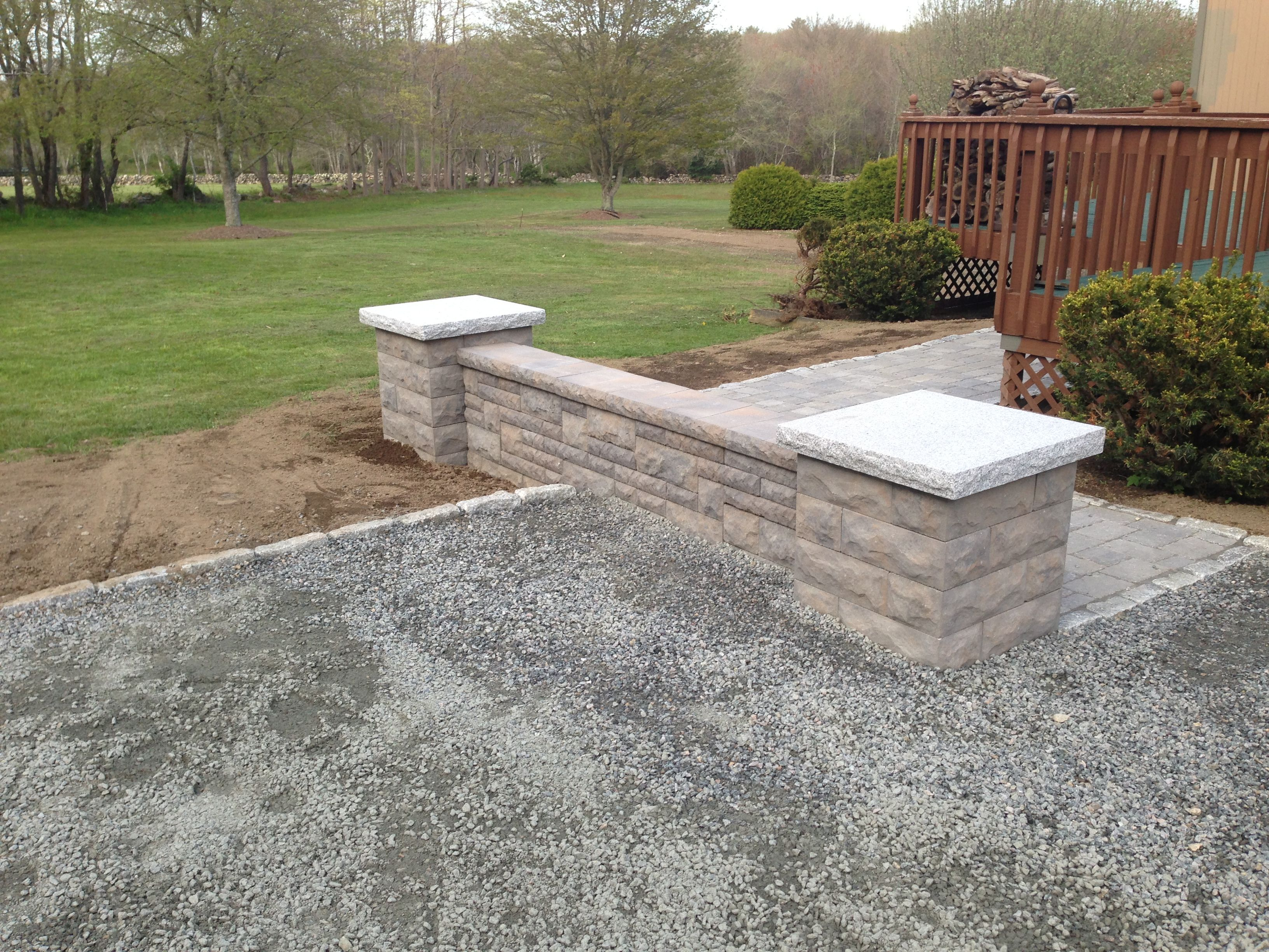 Double Sided Sitting Wall With Two Columns Capped With Granite