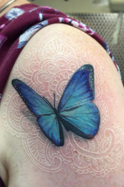 Blue morpho butterfly white madala patterns butterfly