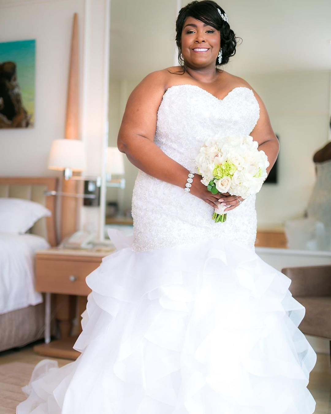 Strapless fit-and-flare wedding gowns for a plus size bride ...