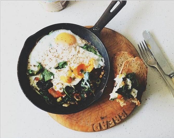 Mouth Watering Brunch Recipes - Baked Eggs: Eggs, spinach, leeks, and chargrilled peppers, topped with ricotta + served with fresh sourdough bread. | Recipe right this way...